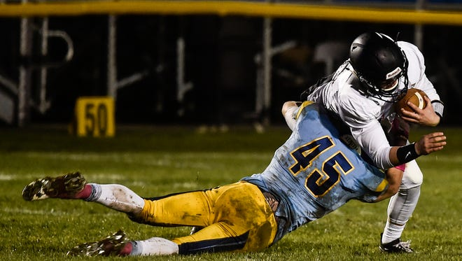 River Valley senior linebacker Nash Fry takes down a Jonathan Alder runner earlier this season. Fry was named All-Star County Defensive Player of the Year for football.