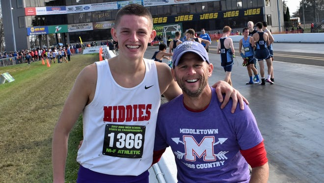 Conant Smith of Middletown celebrates his very close second place finish with his coach David Fultz at the 2017 OHSAA Cross Country Championships in Hebron, Ohio, Nov. 4, 2017