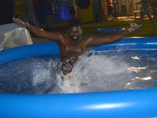 Youth minister Pradeepan Jeeva hits the pool after launching himself off a ramp during Cornerstone Church's Wet and Wild Night.