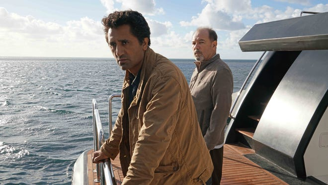 Travis (Cliff Curtis), left, and Daniel (Ruben Blades) take to the high seas in Season 2 of AMC's 'Fear the Walking Dead.' Are there zombie sharks?