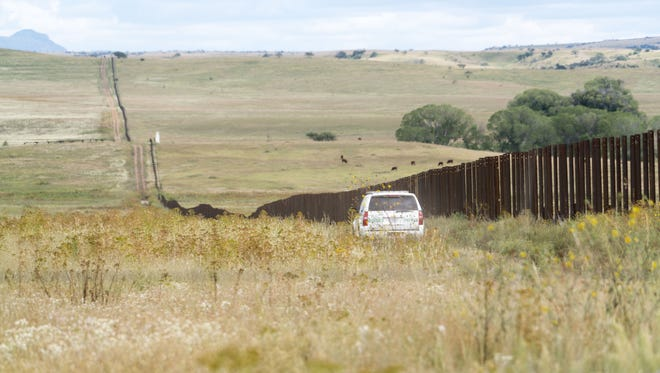 This portion of the U.S.-Mexico border near Naco, Ariz., has a fence. President Donald Trump says he wants a wall, and designs for prototypes are being submitted.