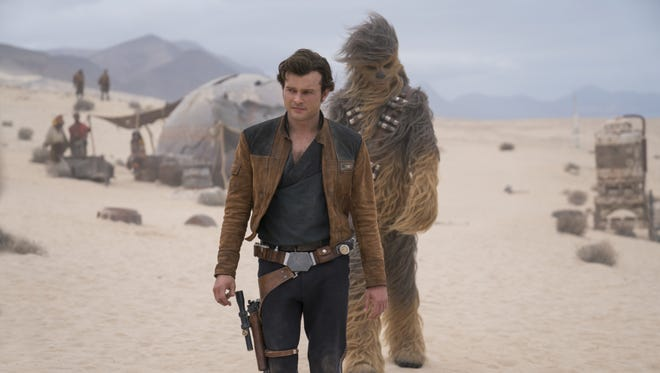 "Han Solo (Alden Ehrenreich) leads Chewbacca in  ""Solo: A Star Wars Story."""