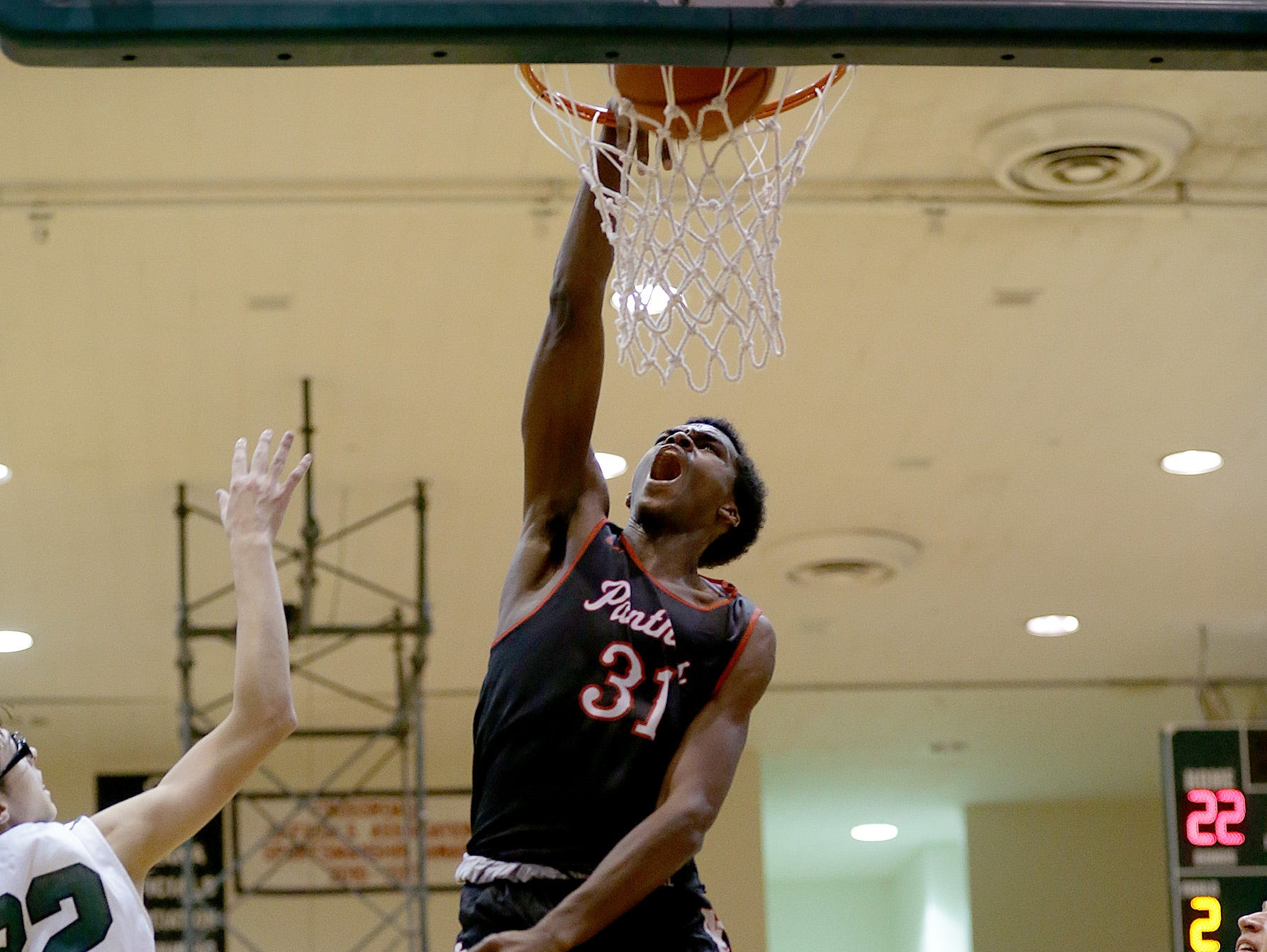 FILE – Kris Wilkes scores 25 points as North Central sets up a sectional final matchup with Lawrence North.