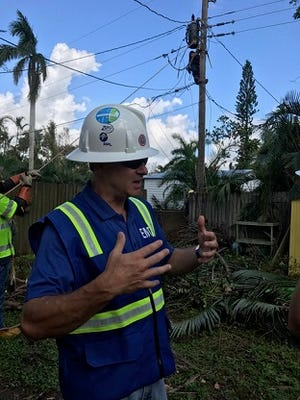 Eric Silagy, CEO and president of Florida Power & Light, made a visit to utility repair crews in Fort Myers following Hurricane Irma in September.