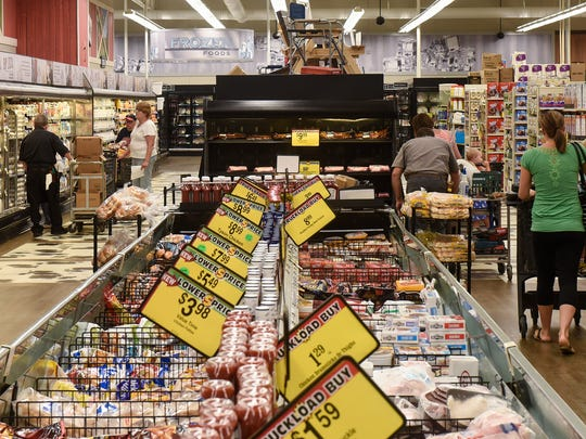 Shoppers walk through the dairy area Monday, July 16, at the Coborn's Marketplace on Cooper Ave. in St. Cloud.