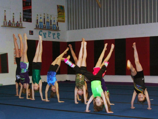 Gymnasts practice their floor routines at Flip-N-Out Gymnastics in Kimbolton.