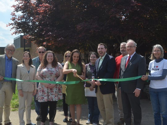 Vol State alumna Cynthia Hernandez cuts the ribbon at the grand opening ceremony of the arboretum at the college on Arbor Day, April 27.