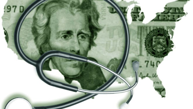 $20 bill and stethoscope