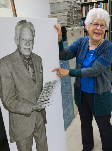 Chief editor Joan Houston Hall displays a photo of founder Frederic Cassidy at the offices of the Dictionary of American Regional English (DARE) at the University of Wisconsin-Madison. The photo was displayed at the DARE goodbye party on Friday. The dictionary pulls together regional words from 1,002 communities across the country, drawn from newspapers, novels, maps, menus, diaries, obituaries and, most of all, from long interviews with ordinary Americans willing to plow through a survey of more than 1,800 questions.