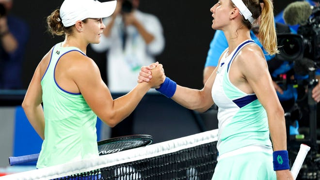 Australia's Ashleigh Barty, left, is congratulated by Lesia Tsurenko of Ukraine after winning their first round singles match at the Australian Open tennis championship in Melbourne, Australia, Monday, Jan. 20, 2020.