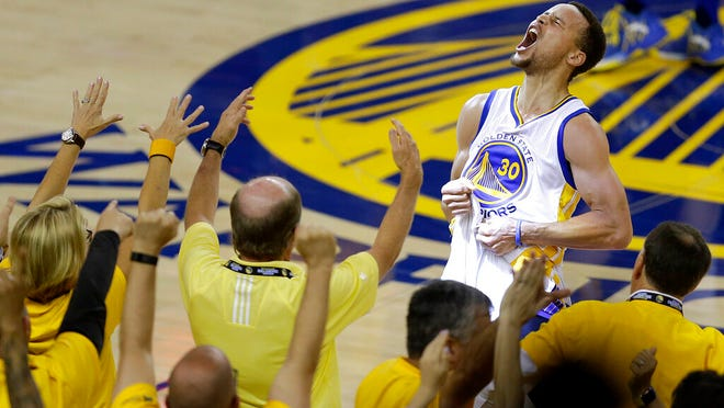 From May 30, 2016, fans cheer as Golden State Warriors guard Stephen Curry yells after the Warriors beat the Oklahoma City Thunder in Game 7 of the NBA basketball Western Conference finals in Oakland, Calif. The roar of the crowd has been a staple of major sports and an advantage for the home team. Playing in empty buildings would require a significant recalibration.