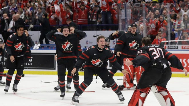 Canada's players celebrate after winning the U20 Ice Hockey Worlds gold medal match between Canada and Russia in Ostrava, Czech Republic, Sunday, Jan. 5, 2020.