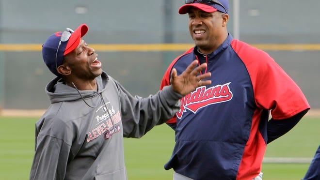 Former Cleveland Indians outfielder Kenny Lofton jokes with coach Eduardo Perez baseball spring training Saturday, Feb. 26, 2011, in Goodyear, Ariz.