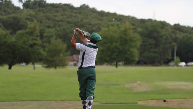 Brad Simon hits the ball down the middle of the fairway in the Little Creek League play Wednesday evening.