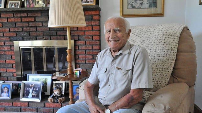Longtime Meals on Wheels volunteer, Peter Fontana Sr., who turns 98 on Aug. 3, relaxes in his Weymouth home. Tom Gorman/For The Patriot Ledger)