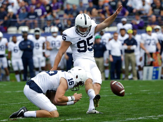 Penn State kicker Tyler Davis, right, scores a field goal as holder Billy Fessler looks on during the first half of an NCAA college football game against Northwestern in Evanston, Ill., Saturday, Oct. 7, 2017. Penn State won 31-7. (AP Photo/Nam Y. Huh)