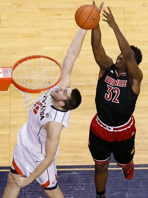 Feb 7, 2015; Charlottesville, VA, USA; Virginia Cavaliers forward/center Mike Tobey (10) and Louisville Cardinals forward/center Chinanu Onuaku (32) battle for a rebound in the first half at John Paul Jones Arena. Mandatory Credit: Geoff Burke-USA TODAY Sports