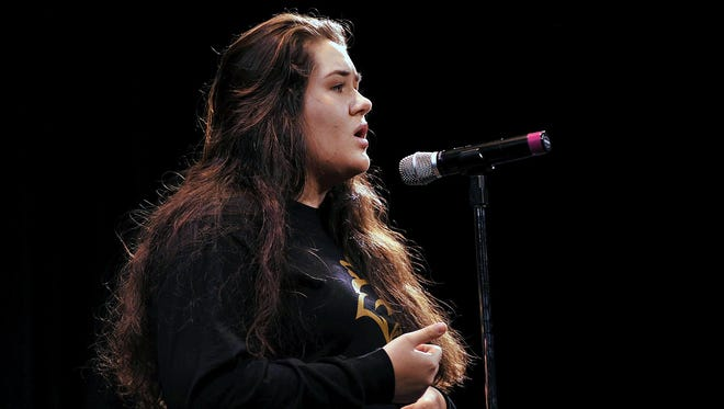 """Vineland High School senior Kathryn Slusarczyk recites """"Mr. Darcy"""" by Victoria Chang during the Poetry Out Loud competition, Tuesday, Jan. 12."""