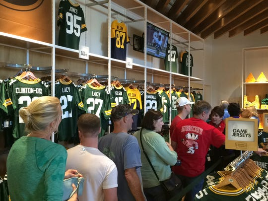 Customers line up to make their purchases at the Packers Pro Shop in Lambeau Field. Darren Lohr, associate store manager, said he is able to look at where the line ends and tell customers exactly how many minutes until they reach the register.