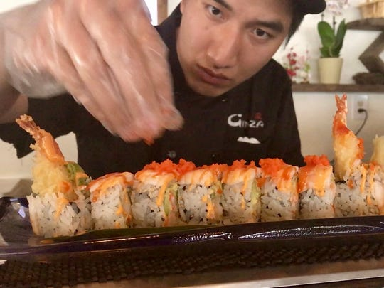 Ginza's sushi chef puts the finishing touches on a