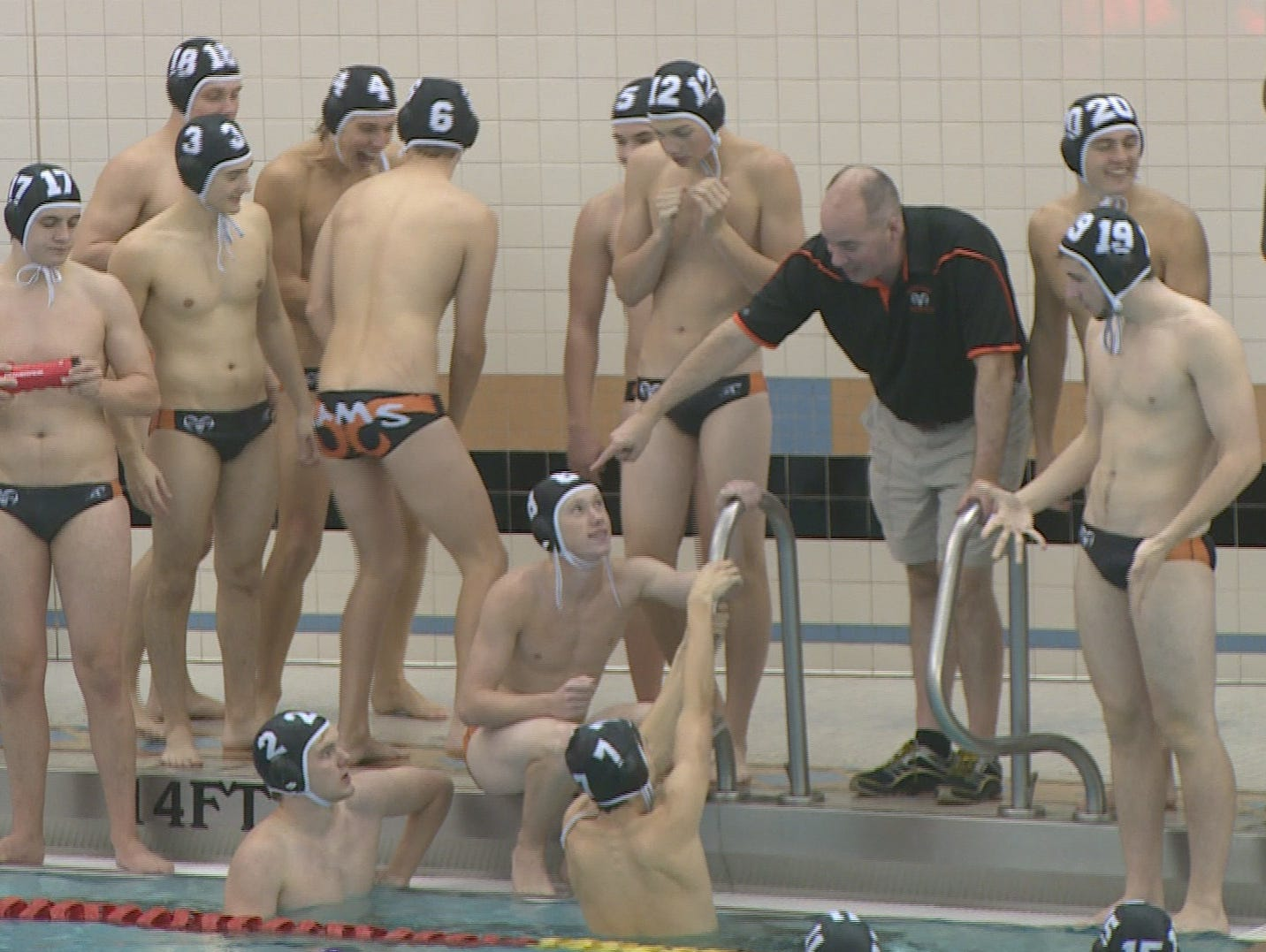 Rockford boys water polo gathers during a timeout.