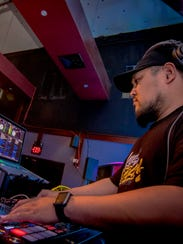 DJ JPOGI fine tuning and mixing tracks before the crowd