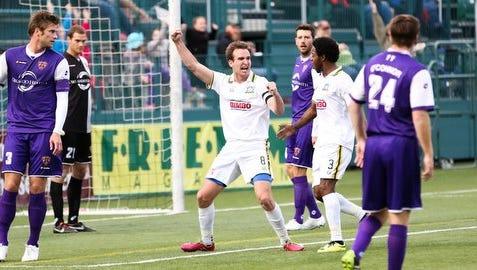 Rhinos midfielder Tyler Rosenlund celebrates scoring the go-ahead goal in the 34th minute of Saturday's 1-1 tie against Orlando City at Sahlen's Stadium.