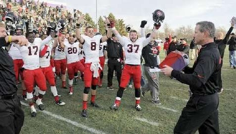 St. Cloud State coach Scott Underwood celebrates a win with his team.