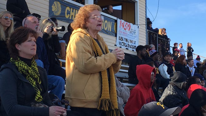 Loretta James of Piscataway cheers for the Piscataway High School football team her two grandson play on during Thursday's Thanksgiving Day game.