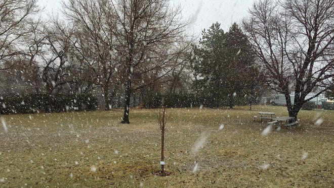 Wind-blown snow falls in Reno on Sunday afternoon.