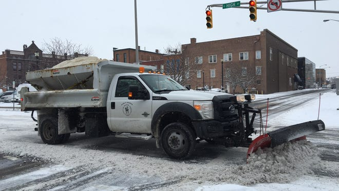 A city snowplow pushes snow on High Street downtown shortly after 9 a.m. Wednesday.