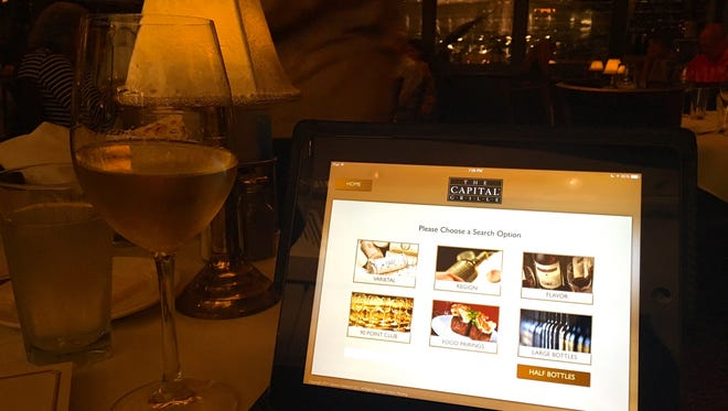 At Capital Grille, you can use an iPad to find a wine.