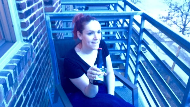Reporter Courtney Crowder enjoys some porch drinking.