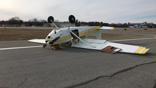 A plane flipped over during takeoff on a runway at the Burlington International Airport on Sunday.
