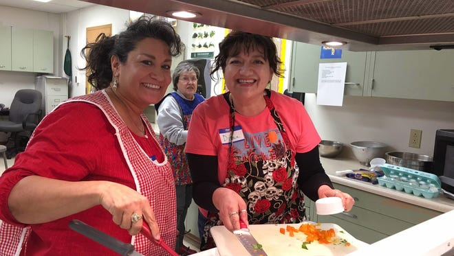 Nancy Lynn Lucero, left, and her sister Diane Madrid prepare quick and easy Spanish eggs at Kitchen Creations cooking school for adults with diabetes. Their mother Jane Madrid, background, also participated.