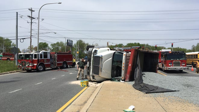 A truck carrying gravel tipped over Monday in Ogletown and closed Salem Church Road headed southbound.