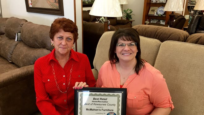 """Marilyn Rank, left, and Dana Roberts of McMahon's Furniture display the award for """"Best Retail"""" they received in the Best of Kewaunee contest."""