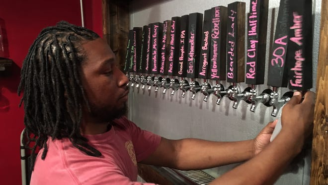 Randy Anderson works the taps at Autauga Creek Craft House in downtown Prattville.