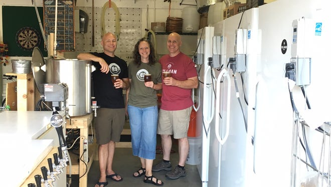 Hillman Beer is opening later this year in South Asheville, the latest addition to a growing craft beer scene in Western North  Carolina. Pictured are owners (left) Greig Hillman, his wife Brandi and brother Brad Hillman, who will do the brewing