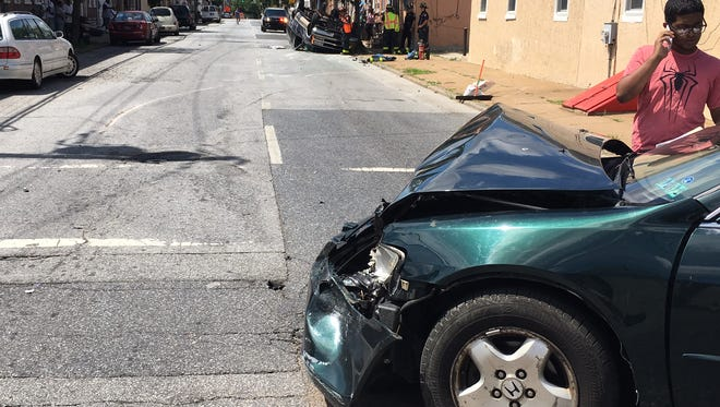 A vehicle overturned along Ninth and Spruce streets Thursday in Wilmington.