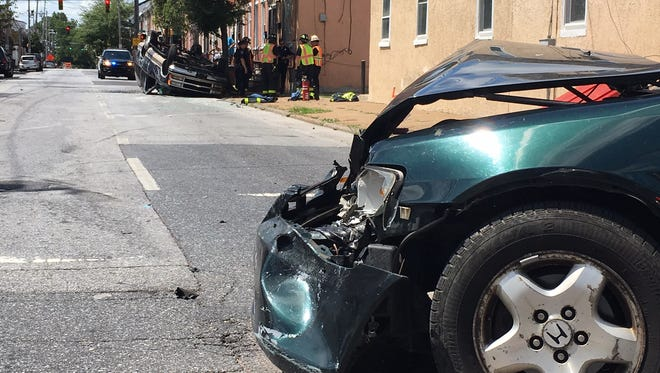 A vehicle overturned in a crash at Ninth and Spruce streets in Wilmington on Thursday, Aug. 4, 2016.