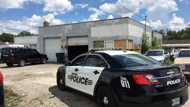 The garage in the 3800 block of North Broadway where police say two men held and tortured three people early Thursday.