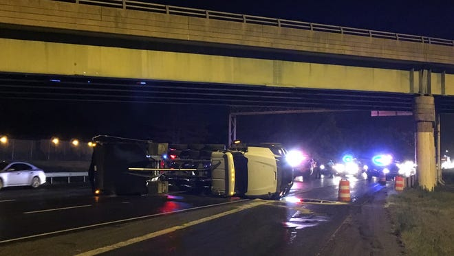 Southbound I-95 was closed at the Del. 273 exit after a dump truck struck an overpass and overturned.