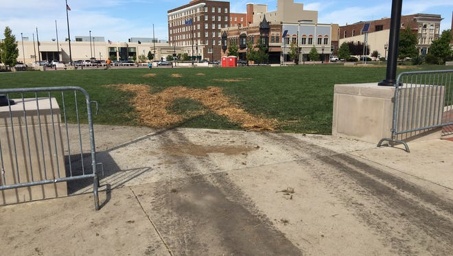 Turf was torn up by a worker's truck at the Canan Commons park in downtown Muncie.