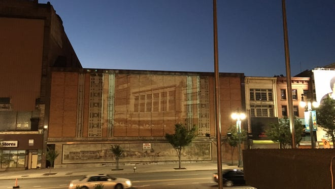 A projected image on one of the buildings on East Main Street in downtown Rochester. This is run a test run of the Re:Main Social event in July. Organizers wanted to show what downtown could be.