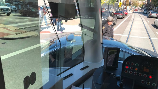 A collision involving a streetcar and a car on Central Parkway and Main Street in downtown Cincinnati temporarily suspended service Wednesday afternoon.