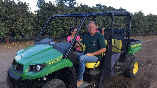 Santa Paula Rotary's Chris WIlson volunteers at the Pumpkin Patch at Limoneira Ranch.