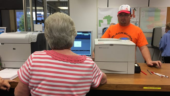 Austin Reiter of Yorktown voted early Monday at the Delaware County Building, Election officials had him remove his Donald Trump hat while he was in the election office.