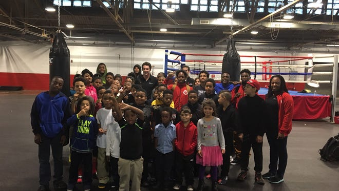 Simon Pagenaud and Team Penske engineer Carlos Gutierrez meet with students at the Downtown Boxing Gym on Thursday.