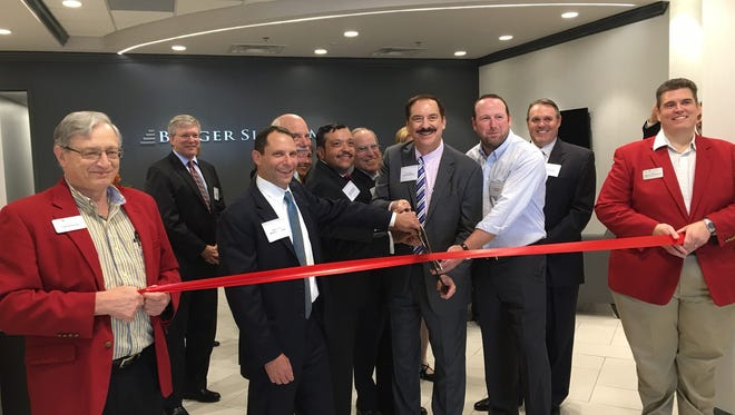 Berger Singerman staff celebrate the opening of the new office with a ribbon cutting.
